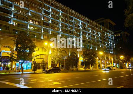 BAKU, AZERBAIJAN - OCTOBER 9, 2017: The scenic hotel edifice with arched balconies, on October 9 in Baku - Stock Photo