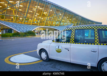 BINA, AZERBAIJAN - OCTOBER 9, 2017: London cab taxis stand beside the main exit from Heydar Aliyev Airport, on October - Stock Photo