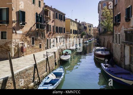 VENICE-MARCH 9: gondolas and boats along a Venice canal,Venice,Italy,on March 9,2017. - Stock Photo