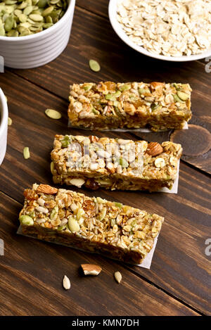 No baked granola bar on wooden table. Healthy breakfast. Energy snack - Stock Photo