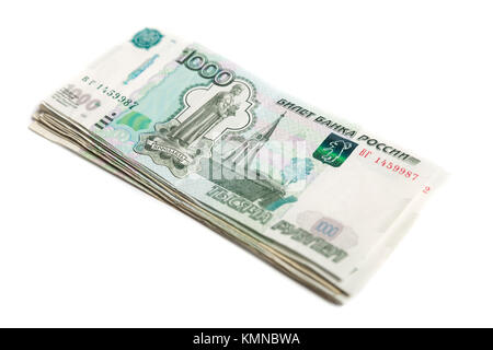 Bundle of Russian one thousandth banknotes isolated on white background - Stock Photo
