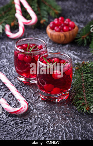 Cranberry drink and fresh berries.   - Stock Photo