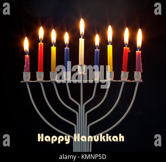 Happy Hanukkah jewish holiday. Menorah traditional candelabra with burning candles against black background - Stock Photo