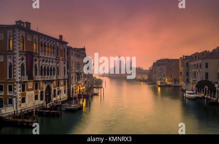 View on Venice: an early morning view from the Accademia Bridge in the mist, towards the church Santa Maria della - Stock Photo