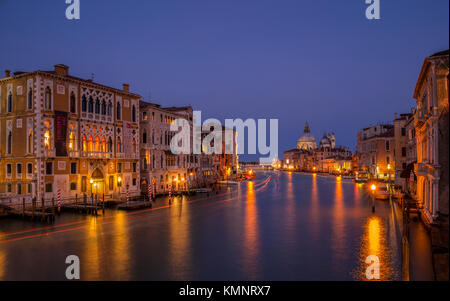 View on Venice: a view at dusk over the Canal Grande from the Accademia Bridge towards the church Santa Maria della - Stock Photo