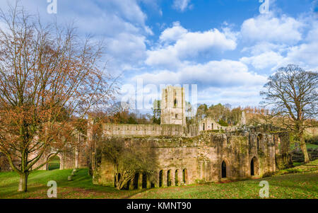 The ruins of Fountains Abbey on a fine autumn morning as viewed from across the river Skell near Ripon, Yorkshire, - Stock Photo