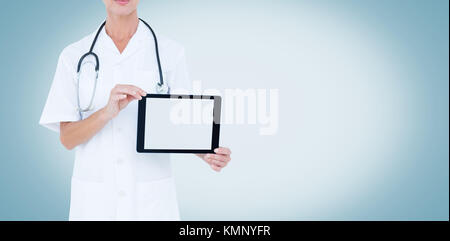 Midsection of female doctor showing digital tablet on white background - Stock Photo