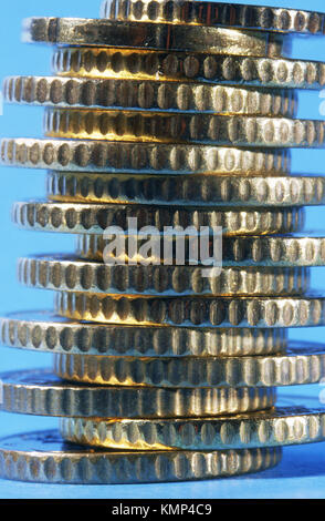 Stacked 50 euro cent coins on blue background - Stock Photo