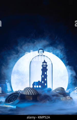 Sea still life with lighthouse silhouette in full Moon. Night ocean scene with smoke on water and copy space. Conceptual - Stock Photo