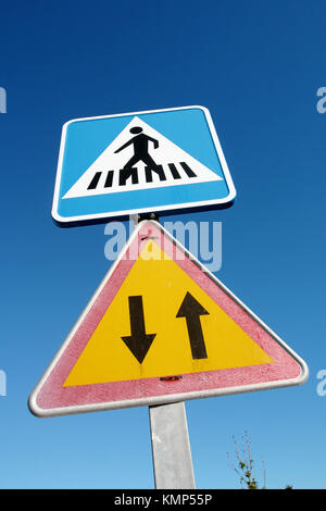 Traffic signs for Pedestrian Crossing and Two Way Traffic - Stock Photo