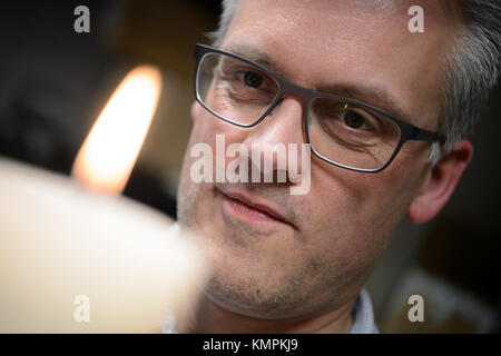Stuttgart, Germany. 5th Dec, 2017. Candle tester Volker Albrecht looking at a candle's flame, in Stuttgart, Germany, - Stock Photo