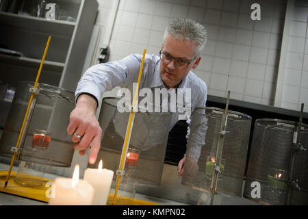 Stuttgart, Germany. 5th Dec, 2017. Candle tester Volker Albrecht points to a candle's flame, in Stuttgart, Germany, - Stock Photo