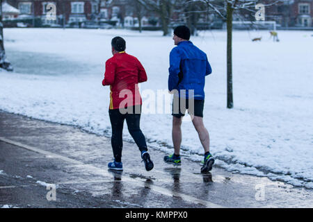 Lisburn, UK. 9th December, 2017. Jpoggers out on a morning run through most of the snowfall in Wallace Park, Lisburn, - Stock Photo
