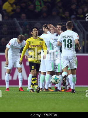 Dortmund, Germany. 9th Dec, 2017. Bremen's players cheer over the 0-1 score during the German Bundesliga football - Stock Photo