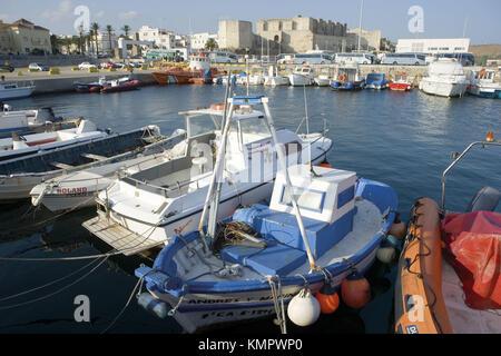 Fishing boats in port and castle of Guzman El Bueno in background, Tarifa. Costa de la Luz, Cádiz province, Andalusia. - Stock Photo
