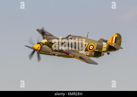 Hawker Sea Hurricane and Hawker Sea Fury flying in very close formation at The Shuttleworth Collection Evening Flying - Stock Photo