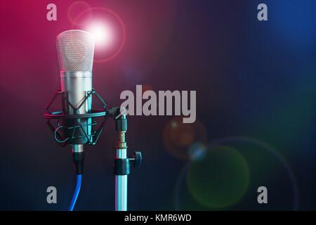 Microphone in the night colorful light in a recording studio - Stock Photo