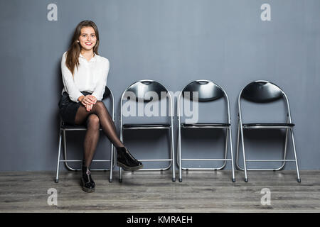 Young woman waiting for job interview in reception hall - Stock Photo