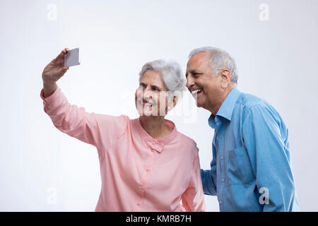 Senior couple taking selfie - Stock Photo