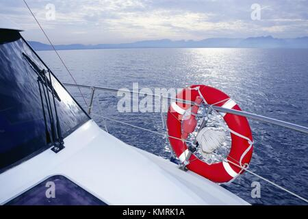 Bue ocean sea view from boat with lifesaver - Stock Photo