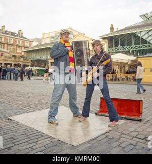 Junior Senior a pop duo from Denmark, photographed busking in Covent Garden, London England, United Kingdom. - Stock Photo