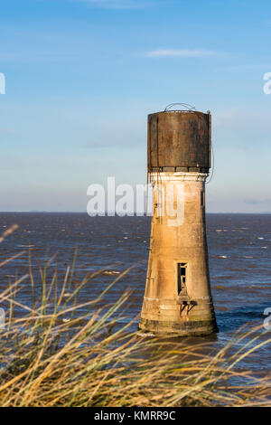 Old Lighthouse and Water Tower at Spurn Point in East Yorkshire - Stock Photo