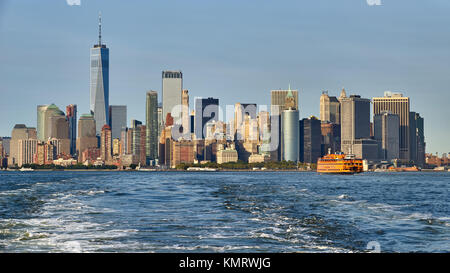 Panoramic view on the Financial District skyscrapers (One World Trade Center) with the Staten Island Ferry. Lower - Stock Photo