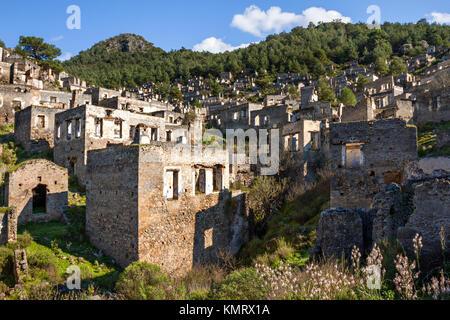 Abandoned houses and ruins of Kayakoy village, Fethiye, Turkey - Stock Photo