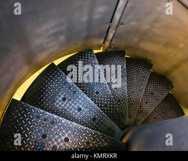 Close up of checker plate metal spiral steps in outdoor staircase leading down steps - Stock Photo