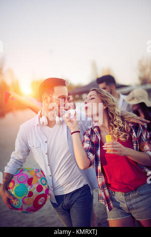 Young people having fun at beach in summer - Stock Photo