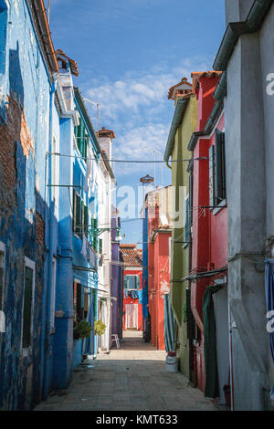 The colorful buldings, canals and boats in the Venetian vlllage of Burano, Venice, Italy, Europe. - Stock Photo