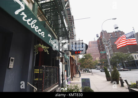 Awning and neon sign for the Tribeca Tavern. New York City. New York. United States - Stock Photo
