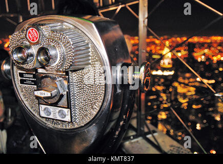 Viewpoint binoculars on top of the Empire State Building. New York City. New York. United States - Stock Photo