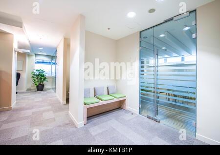 Empty corridor in bright modern office - Stock Photo