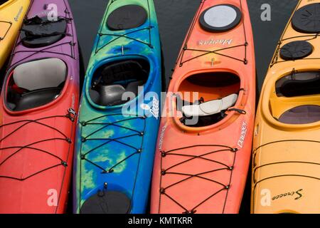 Kayaks lined up outside North Shore Kayak Outdoor Center in Rockport, MA - Stock Photo