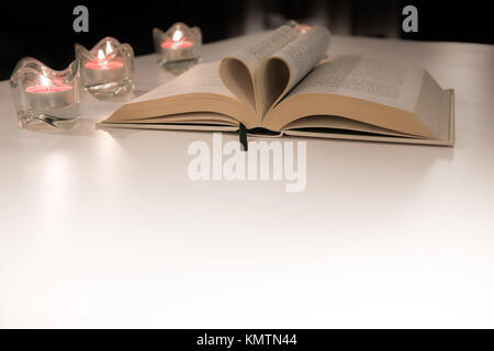 Pages of Book Folded In Shape of Heart - Stock Photo