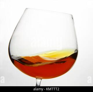Cognac Snifter glass with liquid inside - Stock Photo
