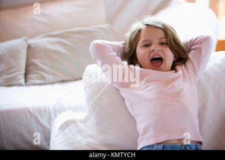 Caucasian girl relaxing on the sofa at home - Stock Photo