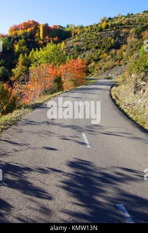 road in a beautiful autumn landscape in Tena valley, Pyrenees, Huesca, Aragon, Spain - Stock Photo