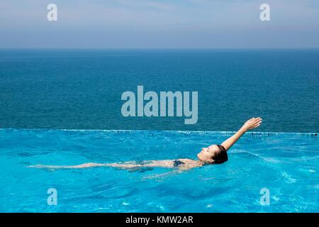 splendid swimming pool in a hotel resort in Kerala state india - Stock Photo