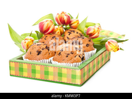 Green wooden tray with muffins and bunch of tulips on white background - Stock Photo
