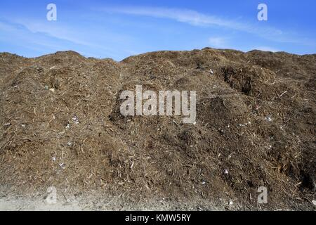 composting ecological compost warehouse blue sky - Stock Photo