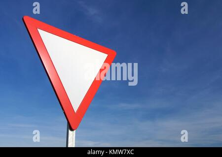 European signal give way to blue sky - Stock Photo
