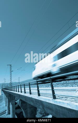 Blue speed train with clear sky - Stock Photo