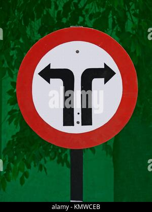 Road signboard showing Left & Right side diversions ahead - Stock Photo