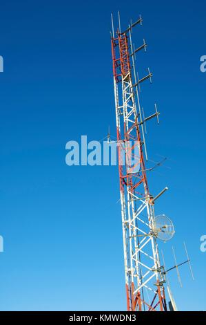 telecommunications tower in white and red - Stock Photo
