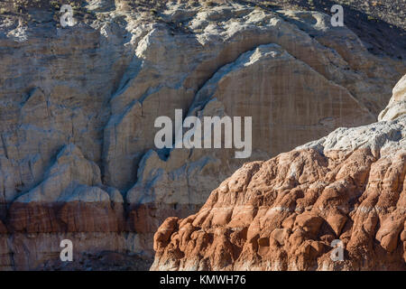 Eroding layers of white and chocolate cliff layers in Grand Staircase-Escalante National Monument near Kanab, Utah - Stock Photo