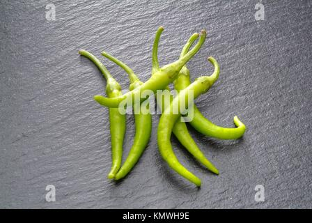 green peppers on stone slate - Stock Photo