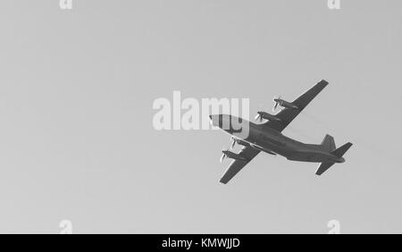 Old Soviet military turboprop cargo plane flies over the city in the may 9 victory day. - Stock Photo