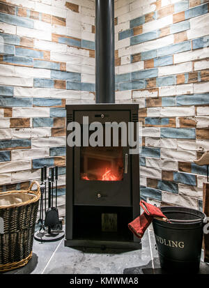 Modern Stove - Log Burning Stove in Modern House with Colorful Brick Style Tiles as a Background - Stock Photo